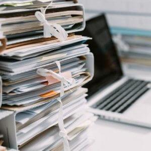 backlog stack of medical files