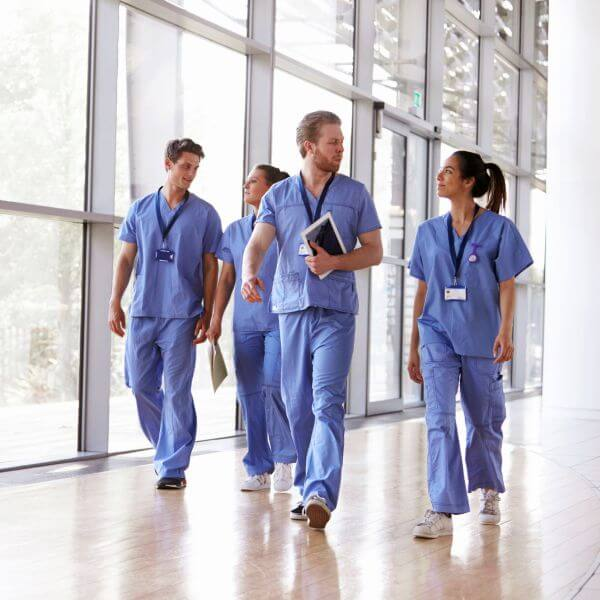 medical nurses walking in hospital