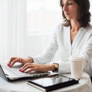 Medical typist typing on laptop